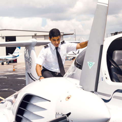Two flight school students getting ready to learn maneuvers in an aircraft.