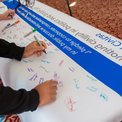 Students sign the Civility Pledge.